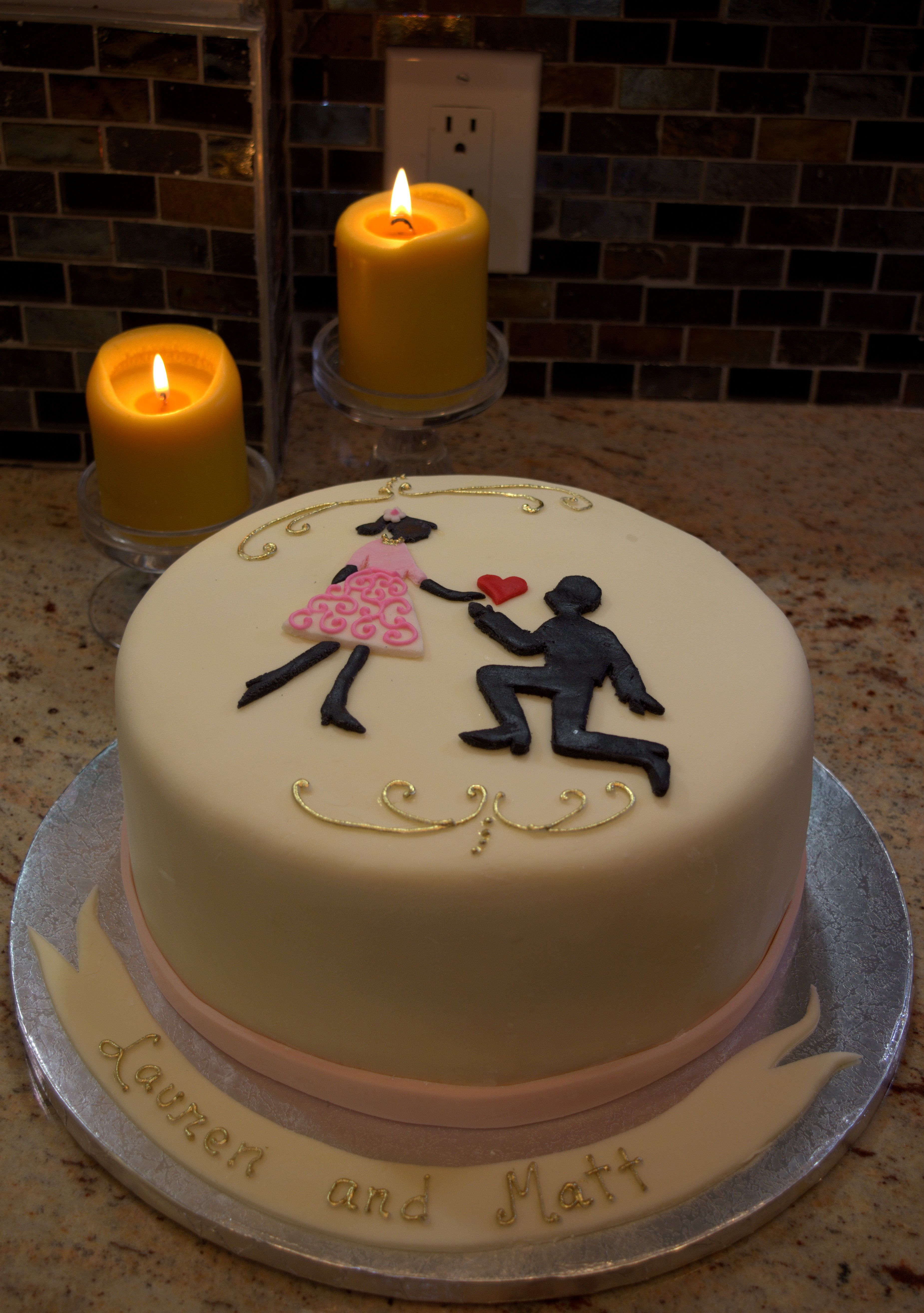 Proposal themed cake with hand made rolled fondant cover Inside is