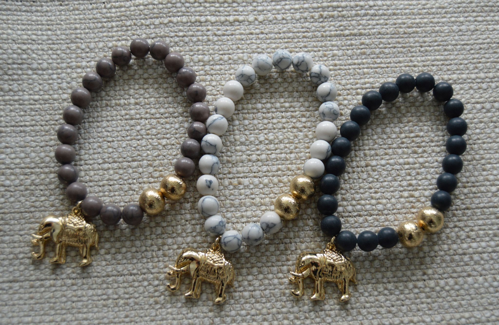 Glass Beaded Bracelet with Gold Accents With Elephant Pendant Stack with other…