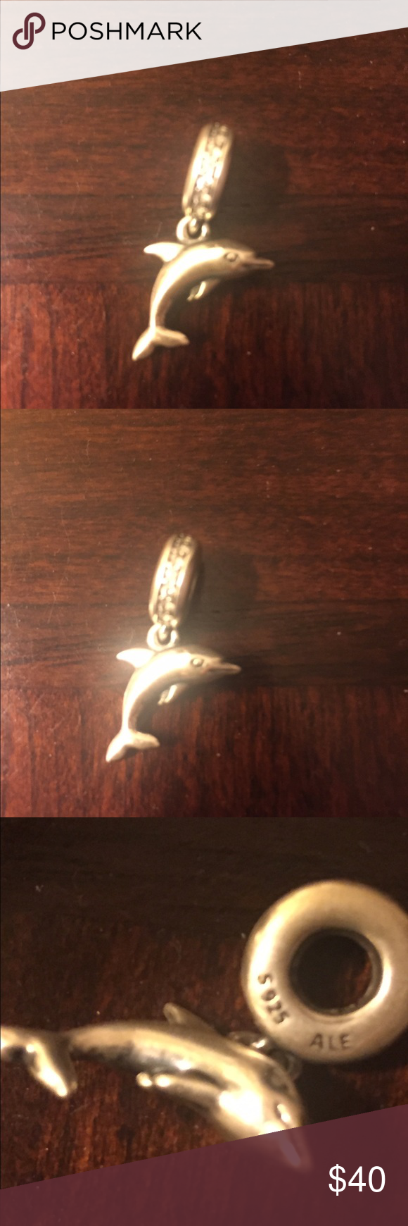 Authentic Pandora Playful Dolphin Charm Authentic Pandora Sterling Silver Playful Dolphin Charm. It is in excellent condition!! Very cute!! Pandora Jewelry