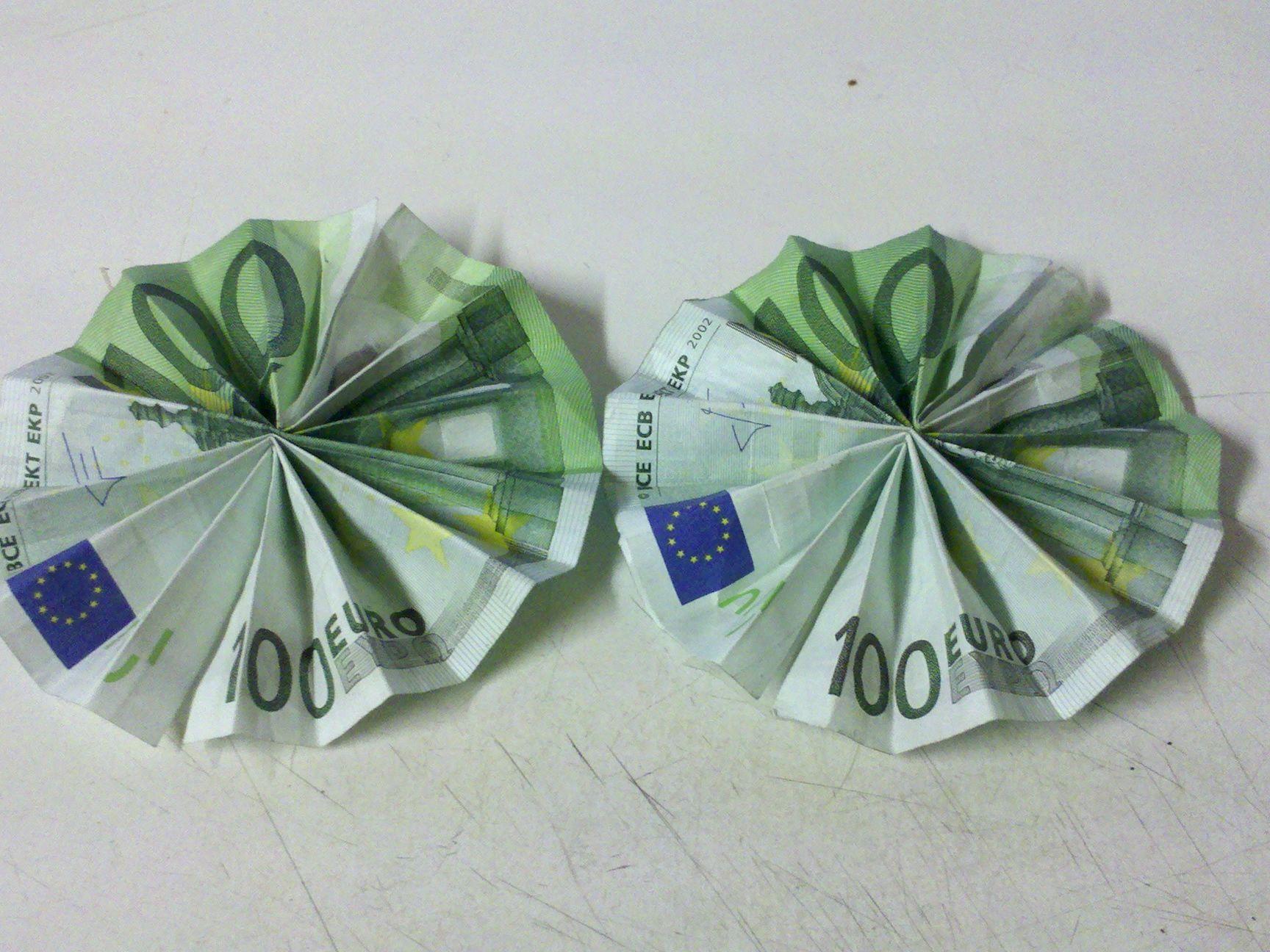 sonne aus geldschein falten geldscheine falten origami. Black Bedroom Furniture Sets. Home Design Ideas
