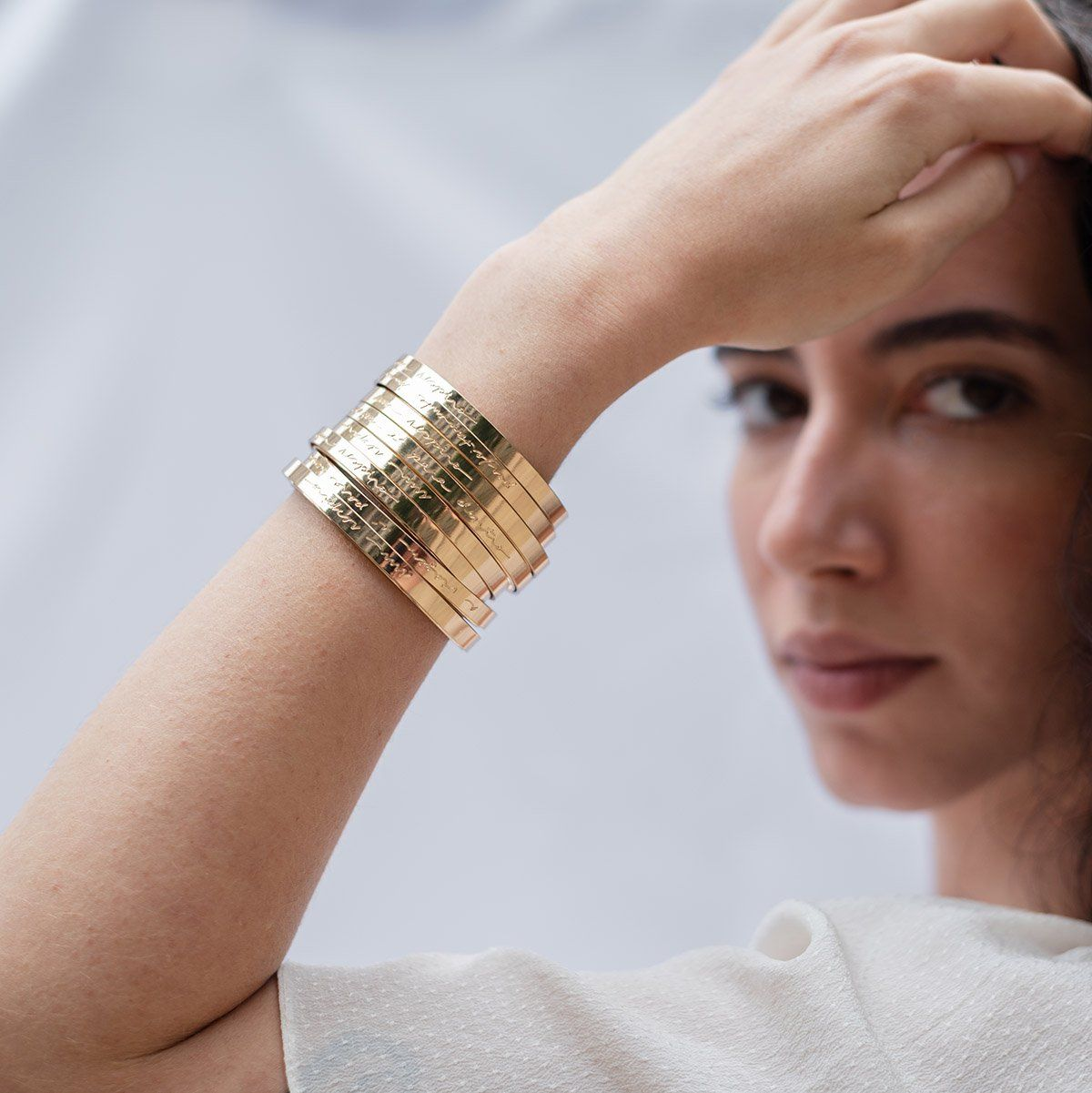 Camila Sarpi manuscript cuffs are gold plated brass and they come with wishes of serendipity Price is for 1 individual cuff.