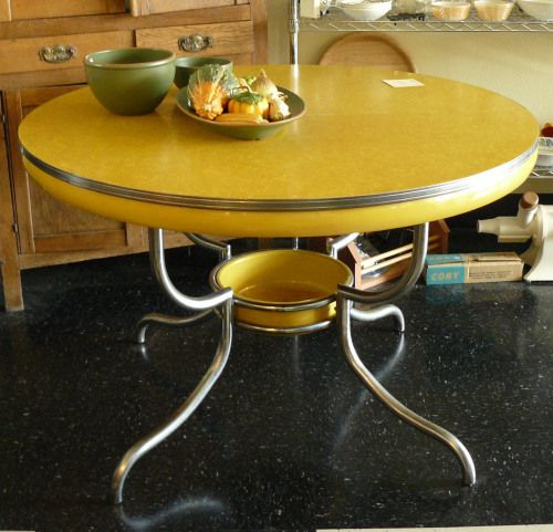 yellow 1950s round formica kitchen table with storage tray