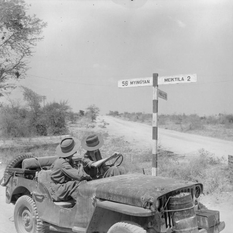 Men From 17th Division Read A Signpost From Their Jeep On One Of