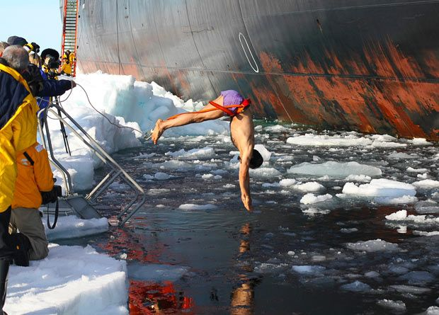 At the North Pole on a Russian icebreaker cruise, this brave tourist takes a stylish 90 degree dive.