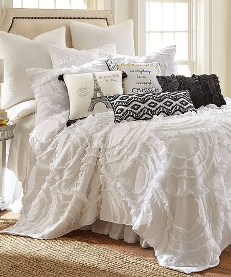 Fall into sweet dreams with this light cotton quilt boasting neutral hues to blend with current décor.