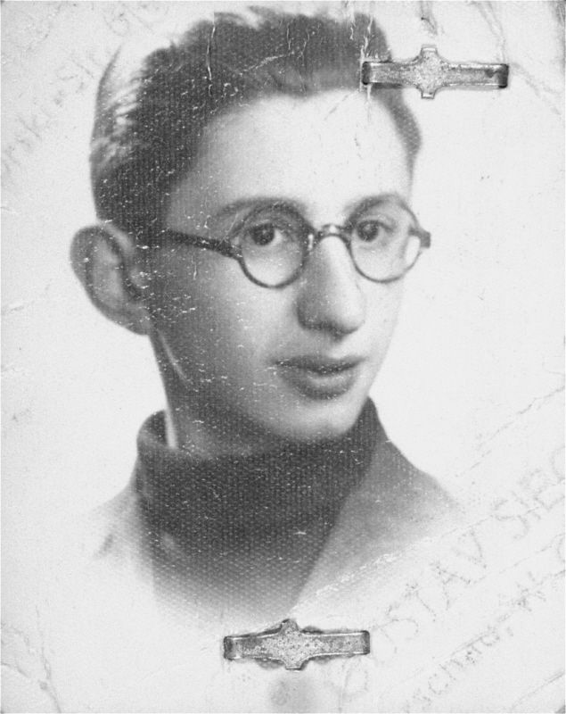 "Portrait of Menachem Borenstein, used for a ""Kennkarte"". He perished in the Warsaw ghetto. The donor noted that Menachem was a bright boy who was interested in science and anatomy and had dreams of becoming a physician.    Mrs. Kolski kept all of her pre-war and wartime photos in a cloth pouch around her neck after her mother appeared to her in a dream telling her to do so. She was thus able to preserve them throughout the two year period she was in hiding."