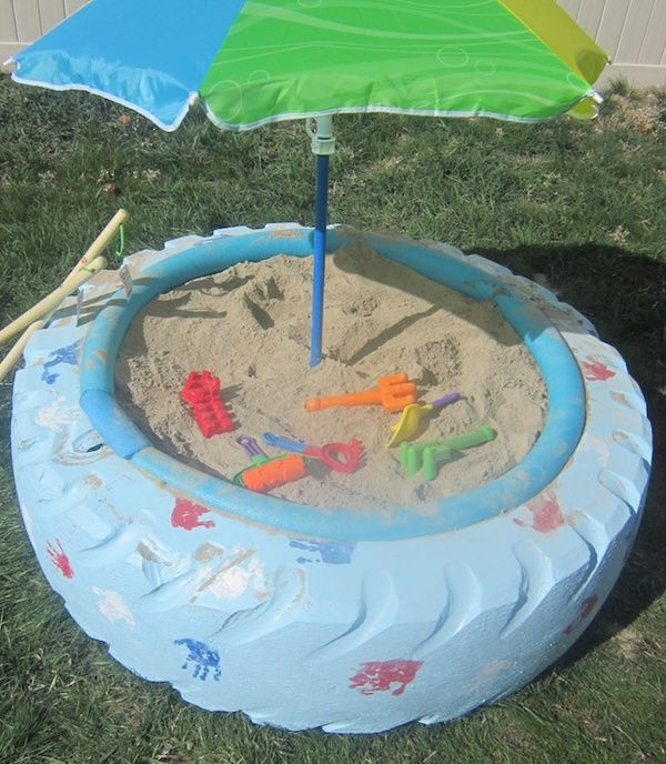 Sand box made of old tractor tires--had one when we were kids but i LOVE the umbrella in the middle!