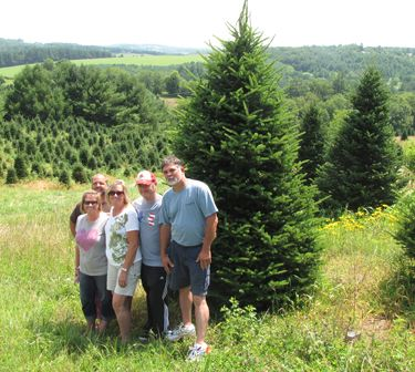 My Family At Mcinnis Christmas Tree Farm In Sparta Nc Tree Farms Christmas Tree Farm Evergreen