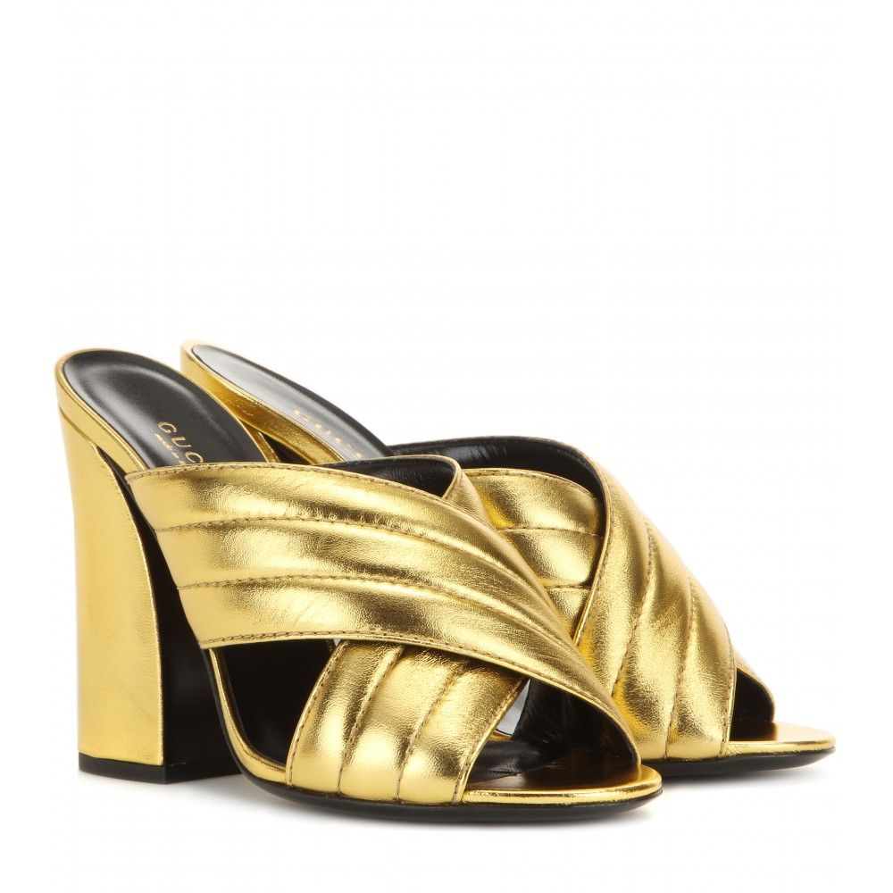caeedbb58915 Gucci - Metallic leather sandals - The crossover shape in its lustrous  yellow gold-tone metallic leather is sure to have heads turning