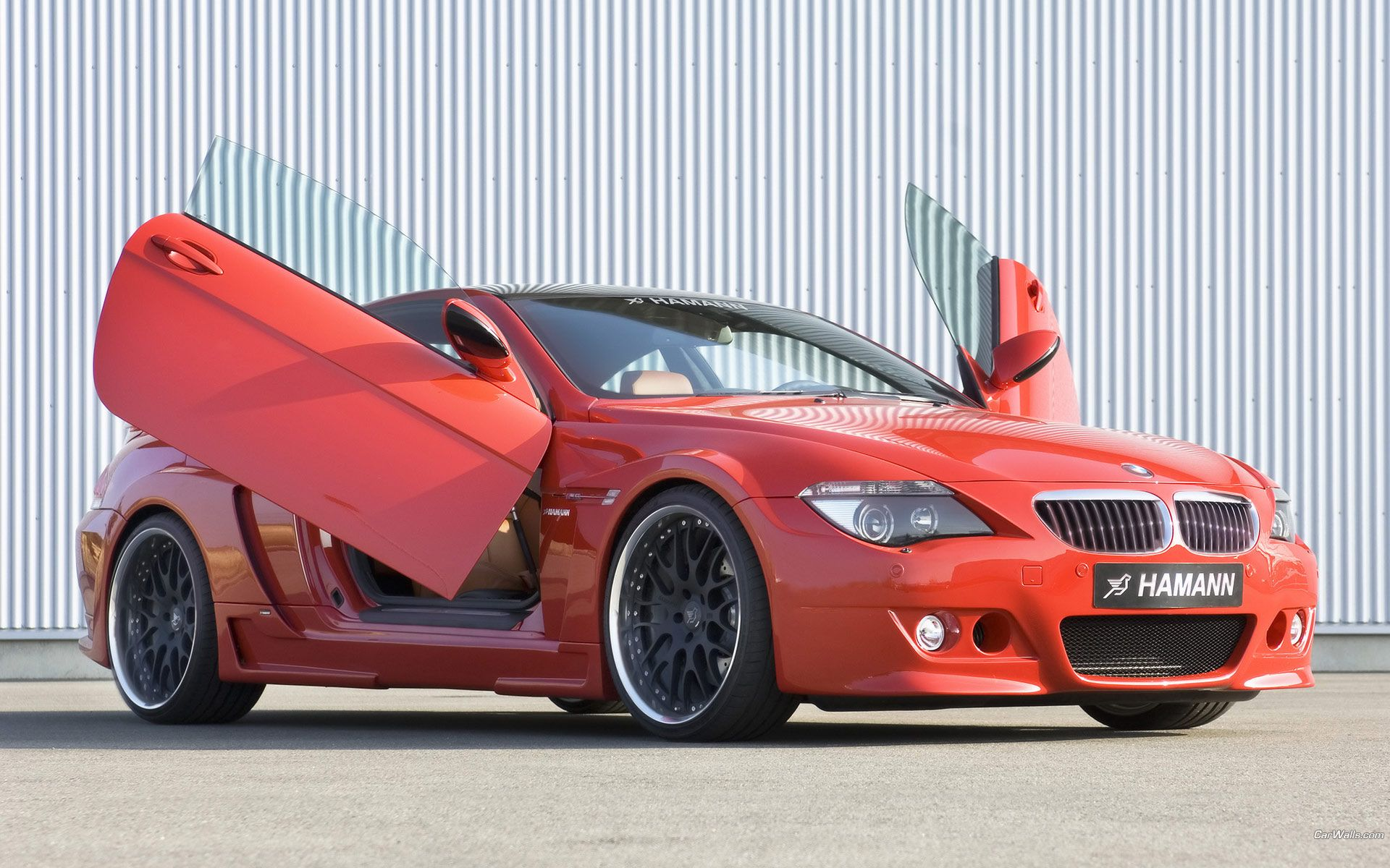 Bmw red with massive rims and lambo style doors