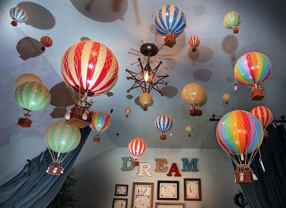 Toy Hot-air Balloons Adorn The Painted Ceiling Within The