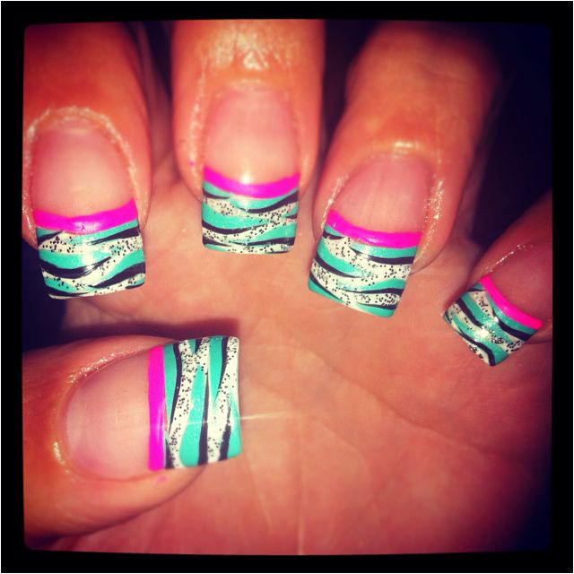 Zebra nails, very pretty but i would prolly leave the turquoise color white.