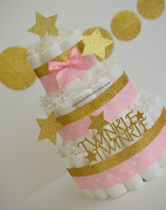 Its a Girl!!! Twinkle Twinkle Little Star!! Love you to the moon and back!!!  These adorable diaper cakes can make a perfect addition to baby shower decor or just as a token of love for a friend to welcome the little star!!  Colors and design can be customized coordinating to the shower theme. ** Pampers swaddler size 1 diapers ** Glitter card stock stars ** Premium ribbons ** Cake board ** Paper shred ** Wooden dowel inside to secure the structure of the cake ** 100% usable diapers…