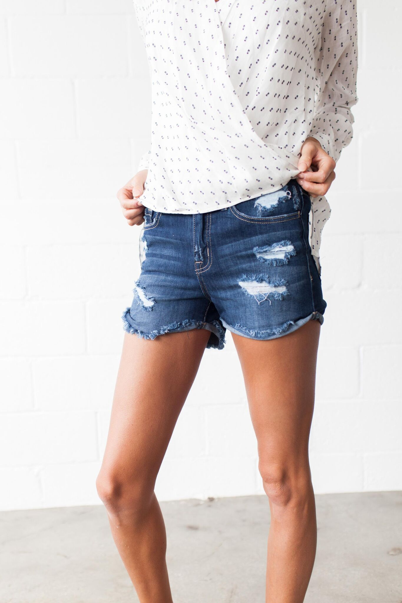 Our Snowcones and Slushies High Rise Denim Shorts feature the standard five pocket style, frayed hem with cuffed sewn sides, and all over distressing. - Unlined - 55% Cotton, 23% Rayon, 20% Polyester,
