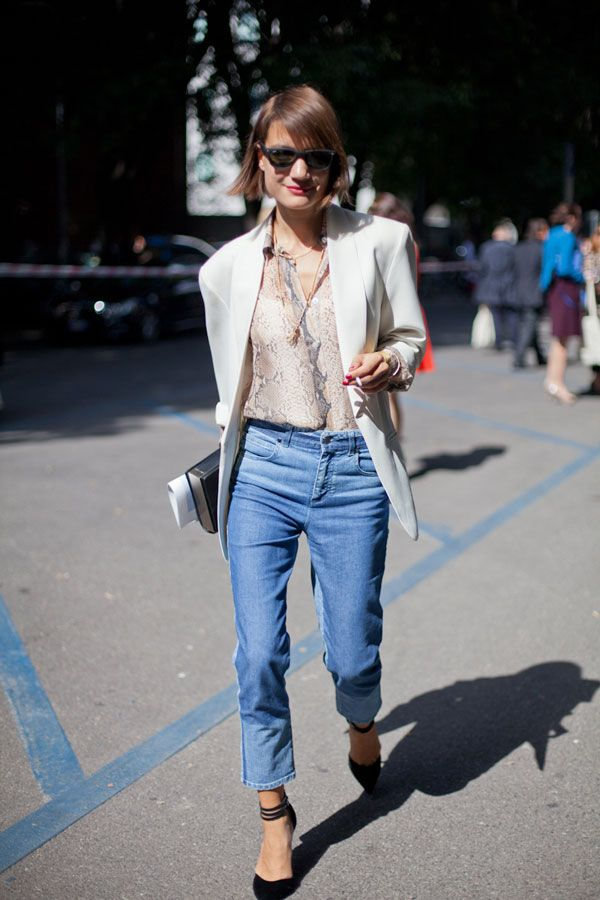 STREET STYLE SPRING 2013: MILAN FW - A snakeskin print blouse and light blazer elevate classic denim.