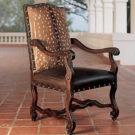 Pretty Axis Deer Hide Chair. Deer Or Seal. An Otter Pillow Would Be Lovely!