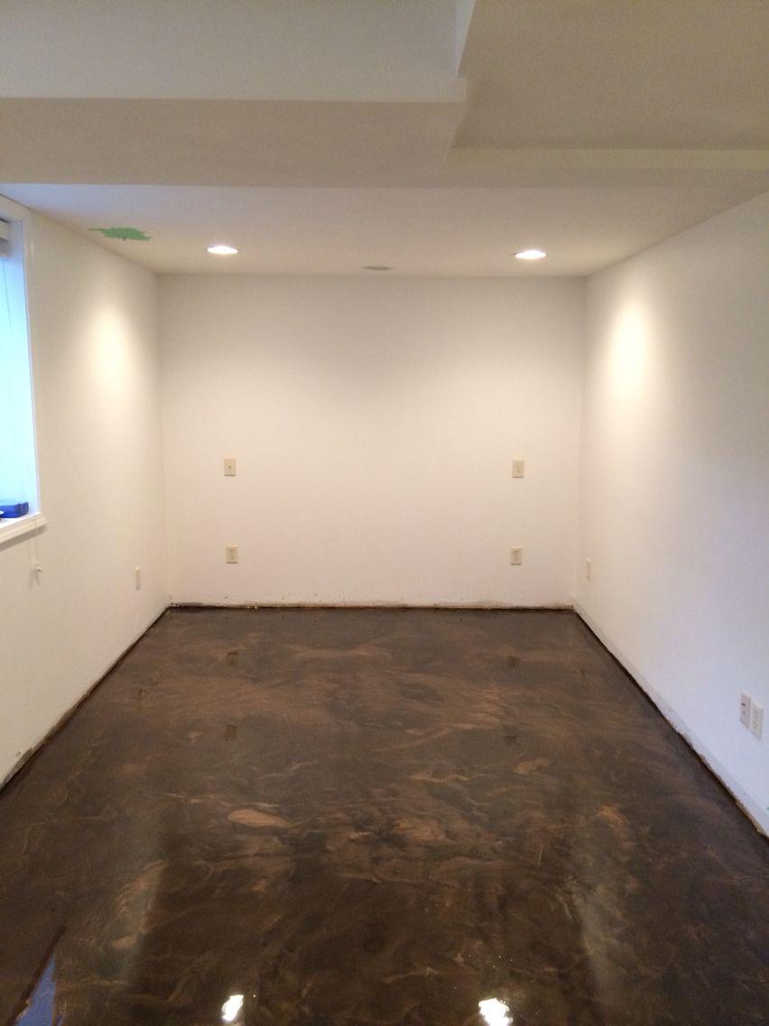 Metallic epoxy basement floor. Colors Brass over Coffee