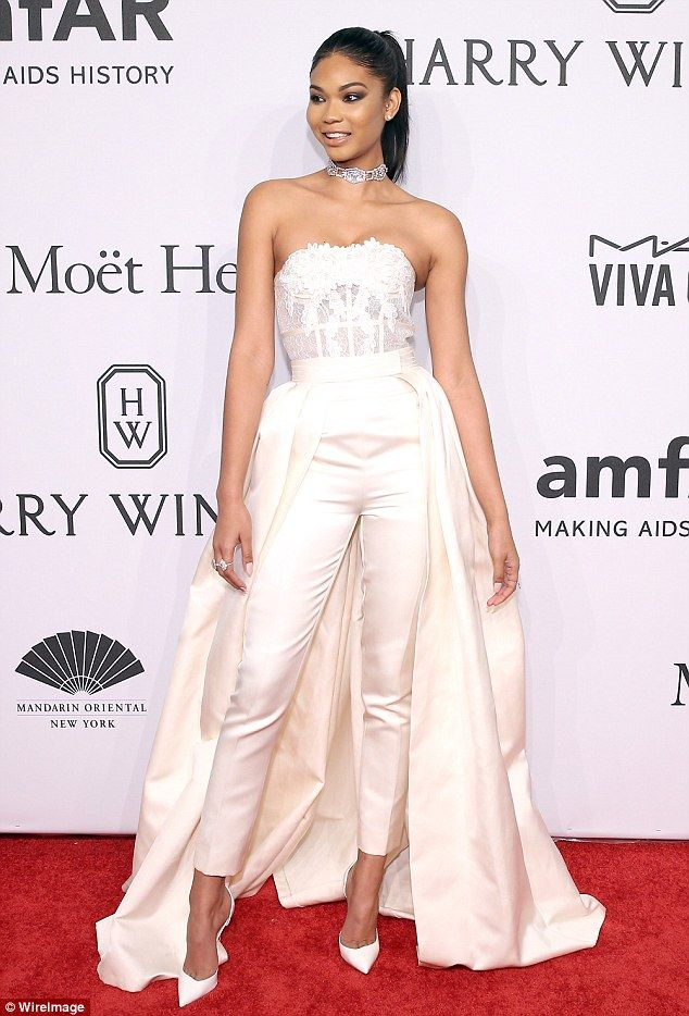 Gorgeous: Chanel Iman wore a lacy white top tucked into silky white trousers