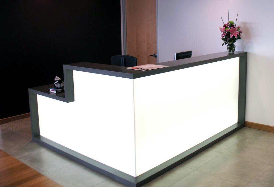 black and white reception desk features lite white plexiglass