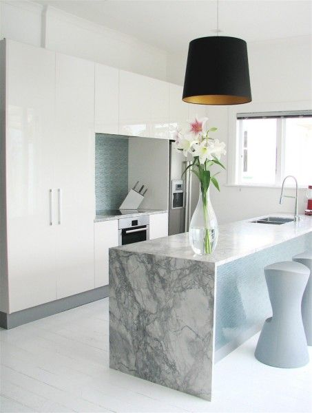 Dramatic Marble Slab With A Waterfall Edge For This Custom Kitchen Island Sleek And Super Modern Cabinets Stools Black Gold Drum Pendant