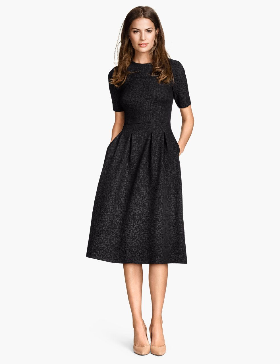 Check this out! Knee-length dress in textured jersey with short sleeves. Seam at waist, flared skirt with pleats at top, and concealed zip at back. Unlined. - Visit hm.com to see more.
