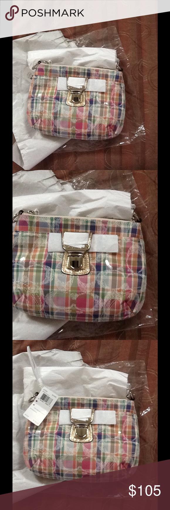 Coach Poppy Madras Swingpack Crossbody Coach Swingpack. Push lock hardware   amp  gilded metallic accents 22b9de12da75f