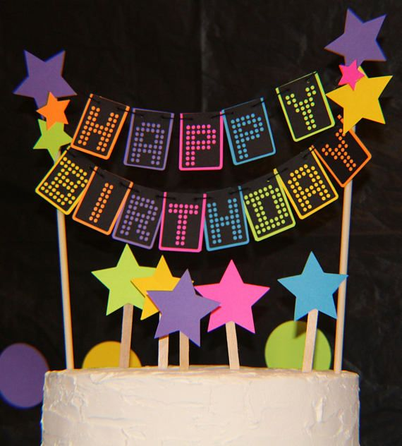 Glow party cake topper FalcoClans glow party cake topper will add a burst of neon color to your glow 80s party decorations. This cake topper is designed using premium neon & black cardstock and strung like a banner on 2 natural wooden skewers. Size of cake topper: 7 wide x 5 tall. Skewer
