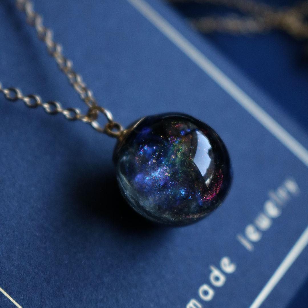 I made a galaxy pendant the orb is made from resin in
