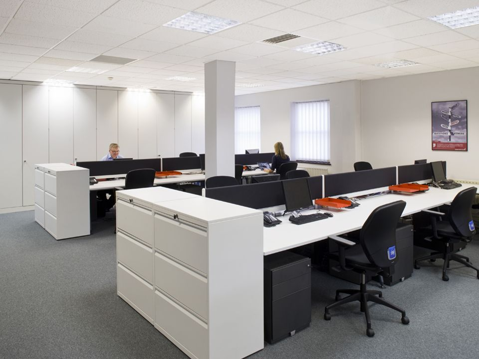 Open Floor Plan Office Furniture: Open Plan Office With Black Pedestals #openplanoffice