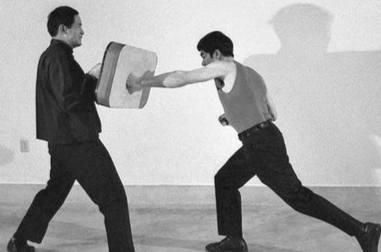 Brucie training on the punching shield with Ted Wong