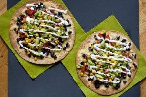 Black Bean Tostada with Avocado Corn Relish; can easily be made into a quesadilla perfect for little hands to grab.