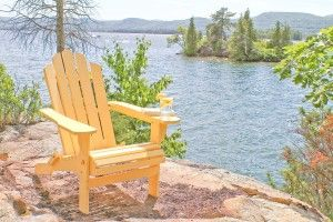 Made by Manchester Wood, these solid maple Adirondack Chairs are designed with a curved back and waterfall front for extra comfort. Wide arms provide a convenient space for setting drinks, books, or other items while relaxing.     The chairs fold for storage in the off-season. Rust-resistant hardware ensures the chairs fold smoothly.