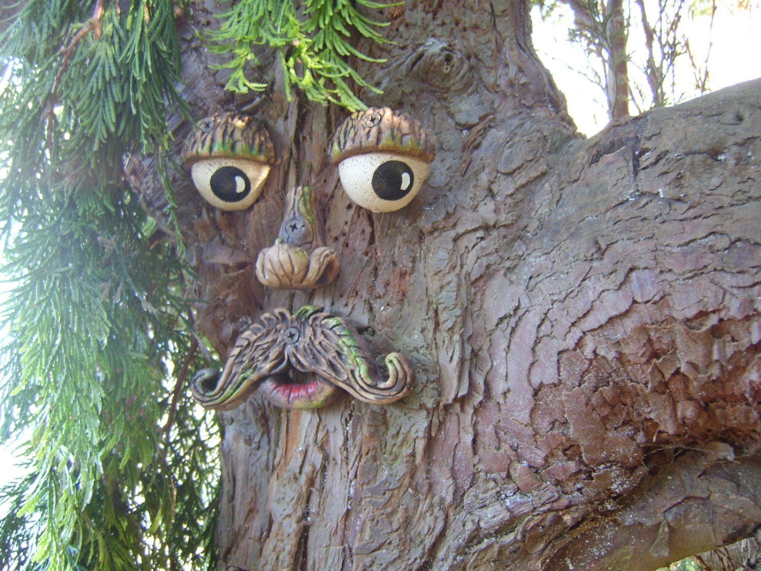 Photo of Tree Face garden decorations, great gifts for all, outdoor sculptures, statues ornaments. garden decorations yard art, funny faces on trees.