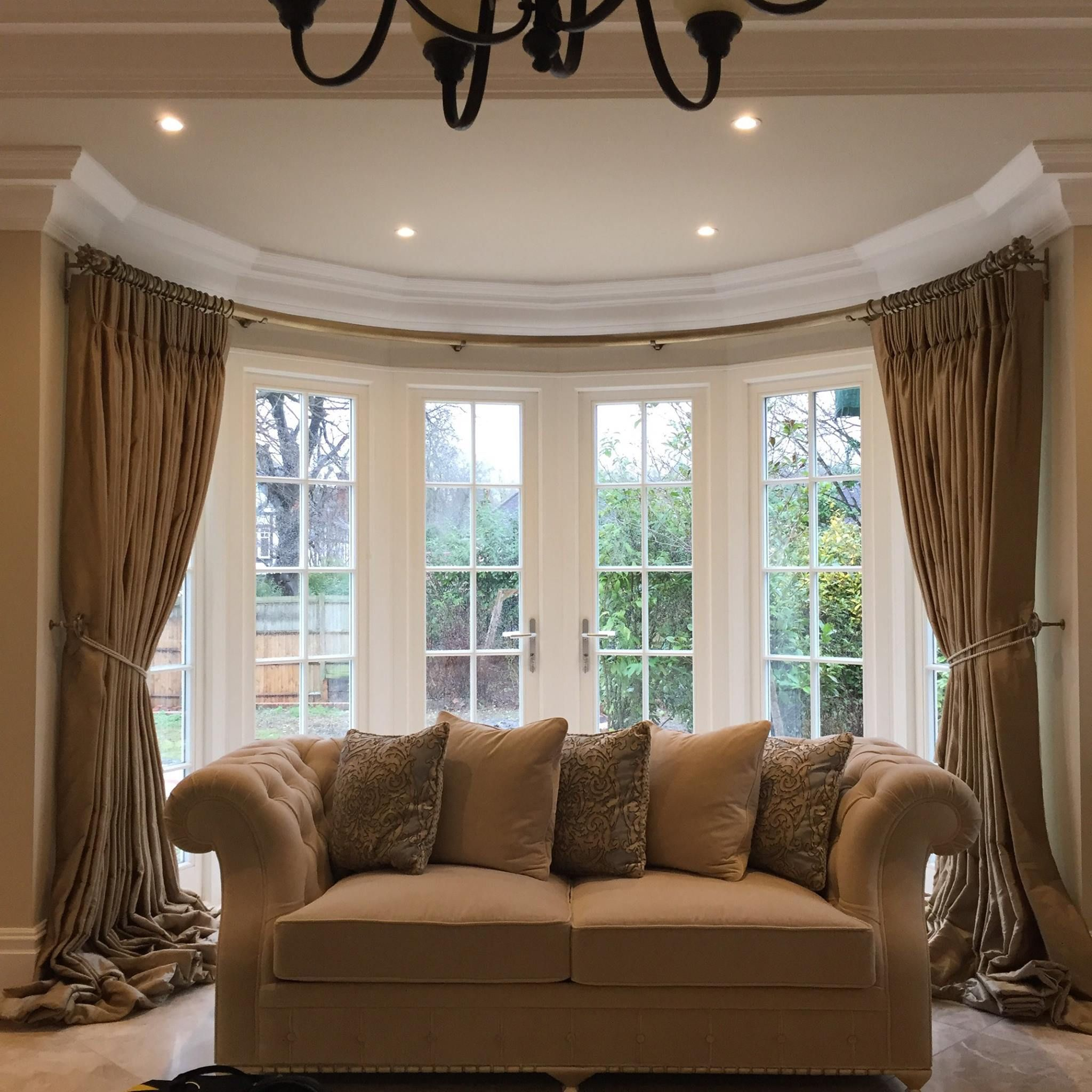 custom pole from hunter hyland sweeps round the large bay. Black Bedroom Furniture Sets. Home Design Ideas