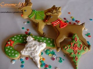 Christmas decorated cookies: reindeer, Christmas trees, candy canes, snowmen, gingerbread kiddos,