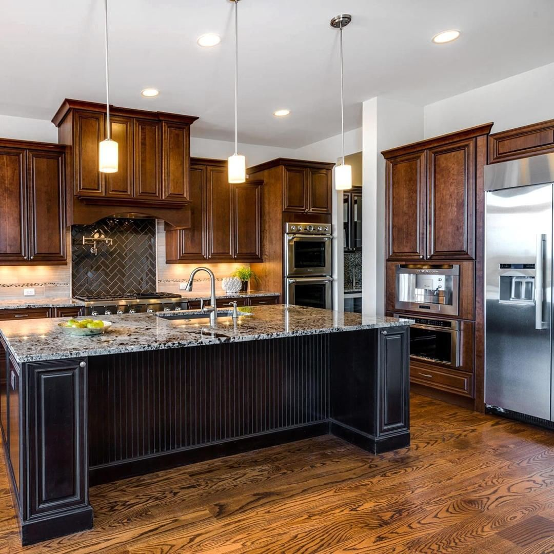 D R Horton Homes On Instagram Dark Wood Cabinets And Black Accents Paired With Natural Bright Light Make This Space In Wood Cabinets Horton Homes Dark Wood