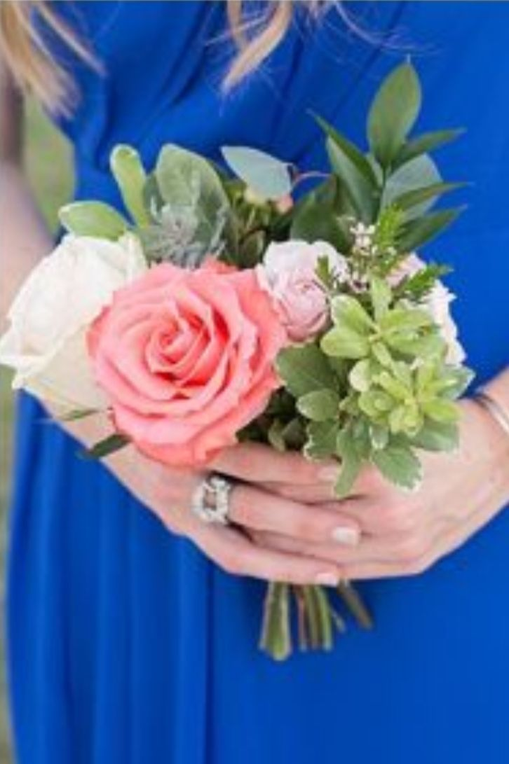 Coral rose bouquet at piazza on the green cobalt blue and coral