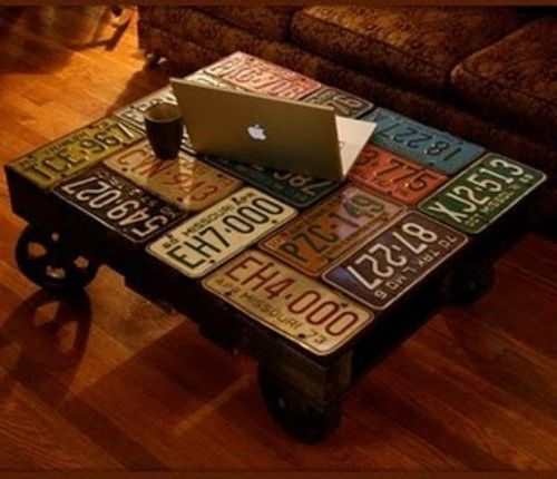License Plate Coffee Table - but could use drinks cans cut open or even the paper labels off drinks bottles as a decoupage...or maps, beer mats, sheet music, concert tickets, pop stars..ok I'll stop! Must do a table like this for teen boy bedroom