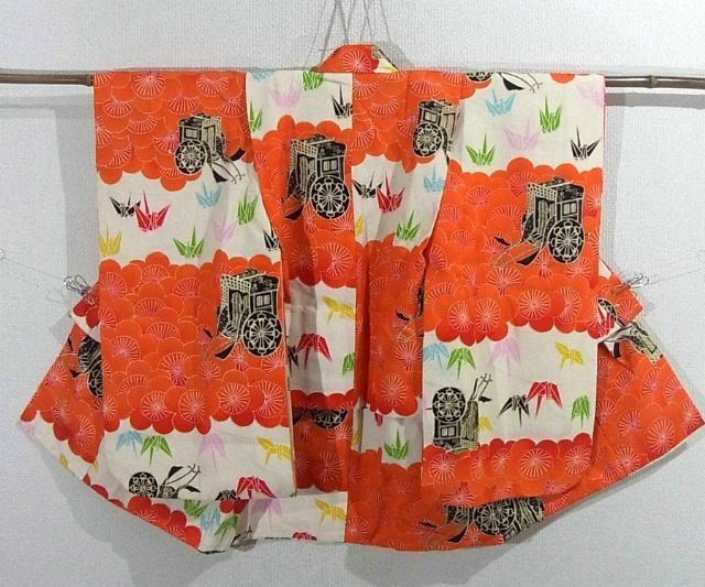 This is an eye-catchy girl's kimono with 'Ume' (plum blossom), royal cart and folded crane pattern, which is vibrantly dyed