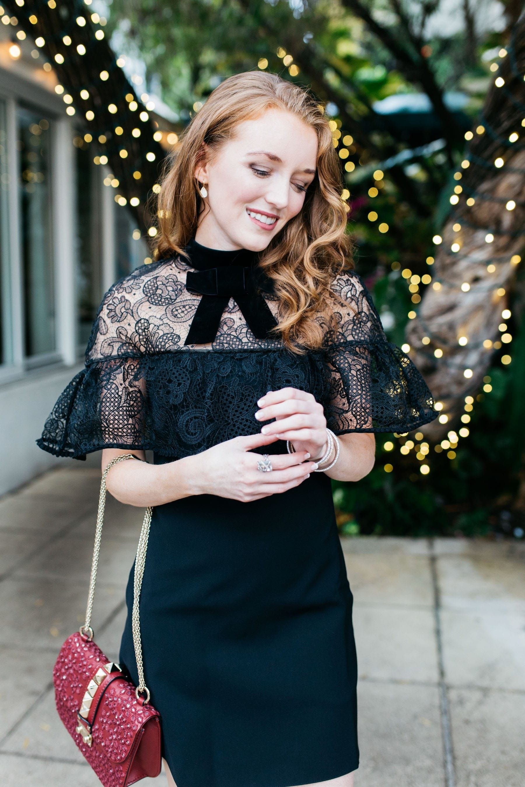 Cozy and Chic Holiday Looks, black lace tie neck top dress and burgundy over the shoulder handbag | Divine Style