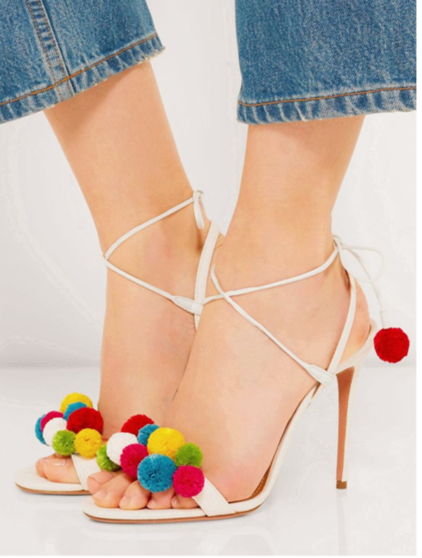 high heels featuring colorful pom poms