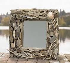 Espelho feito com galhos