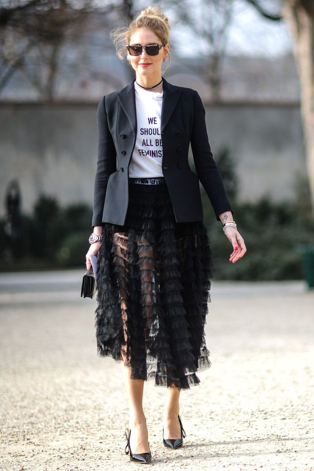 1b4ad96da In this season most wanted ' We should all be Feminists' tee, a black  meshed skirt, and black heels; Chiara attends the Christian Dior Haute  Couture Spring ...