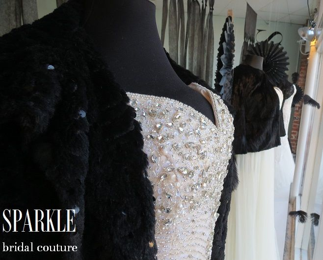 This sparkly, black faux fur sparkly jacket adds extra drama to this glamorous, fully beaded SPARKLE gown.