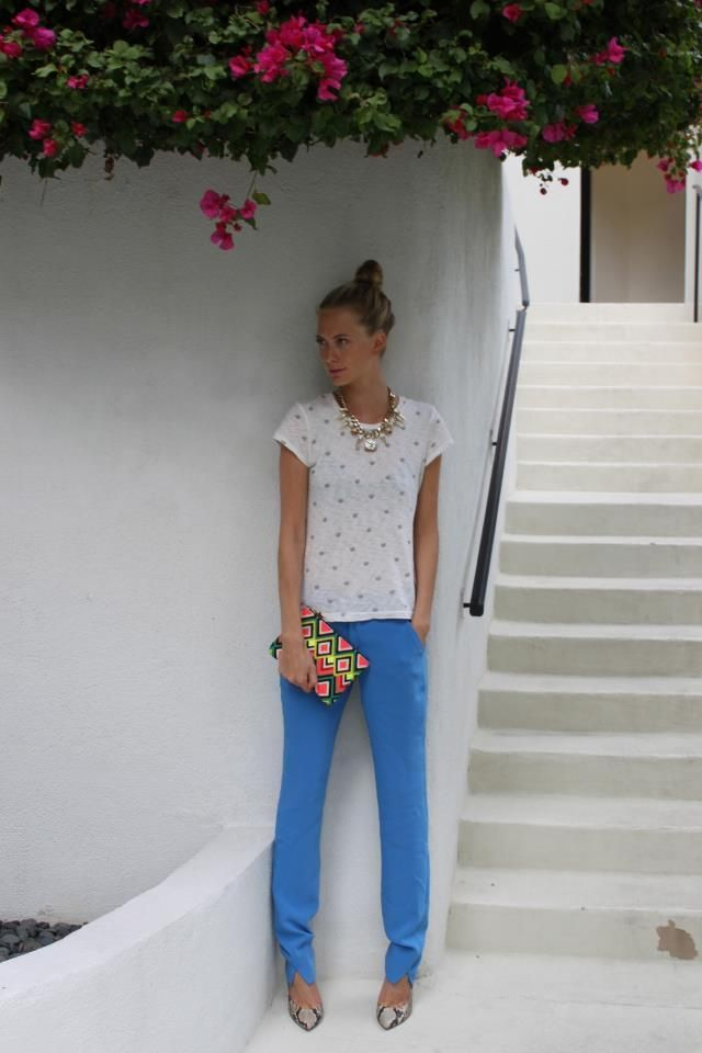 blue pants + sweet white top + heels + bright bag + statement necklace + topknot