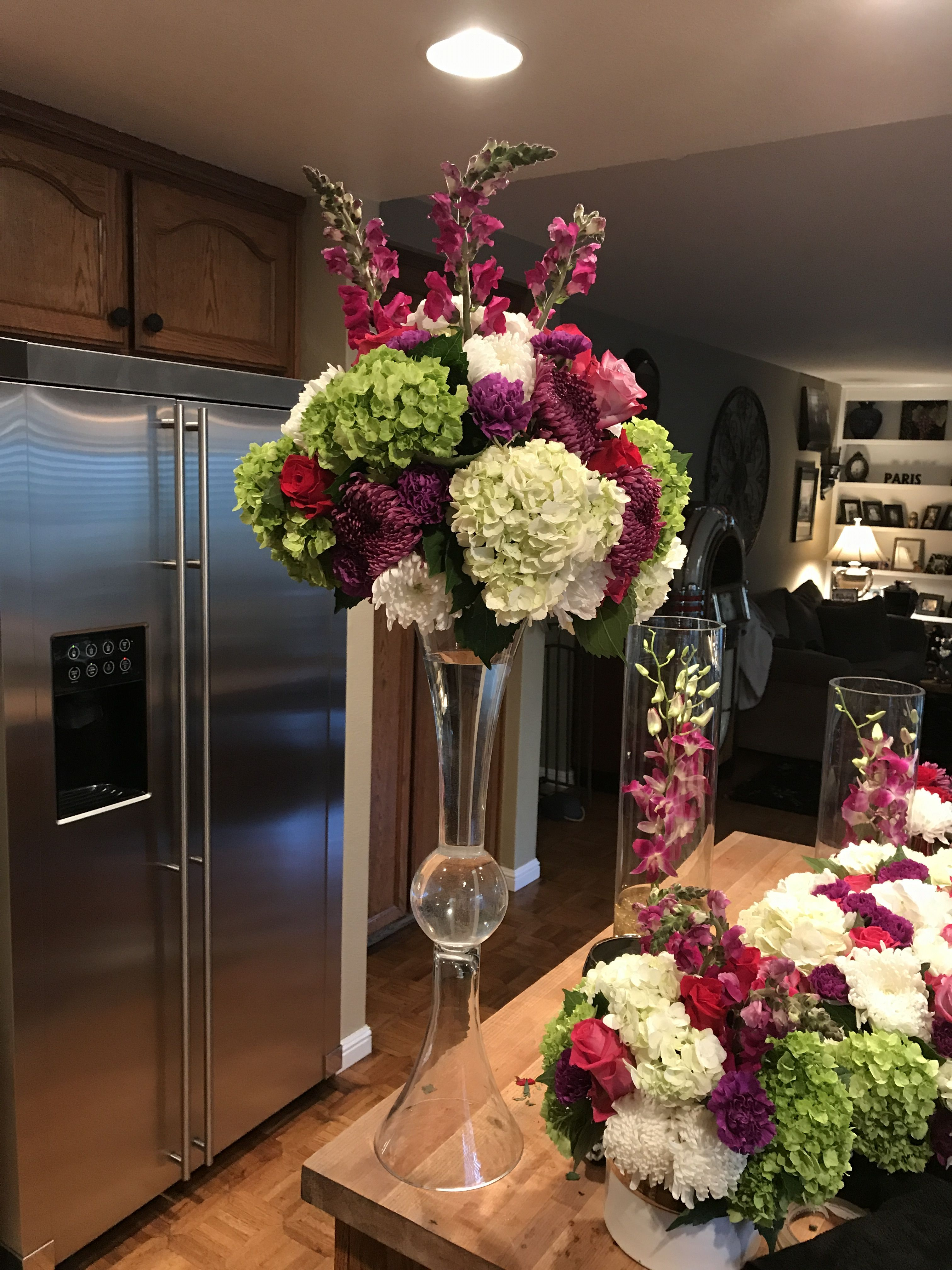 Colorful tall centerpiece in trumpet vase Wedding floral