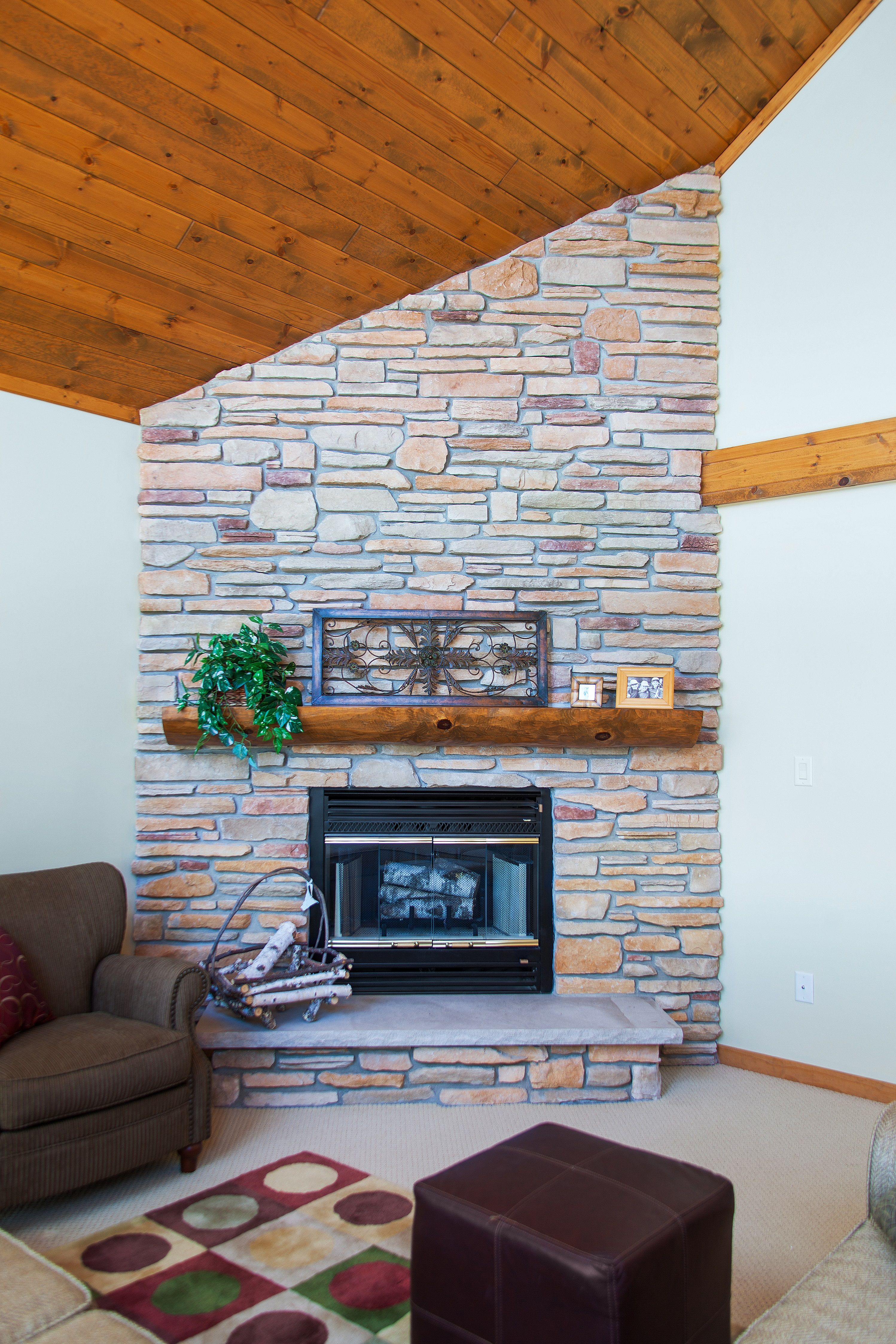 Limestone Fireplace With A Split Log Mantle And Stone