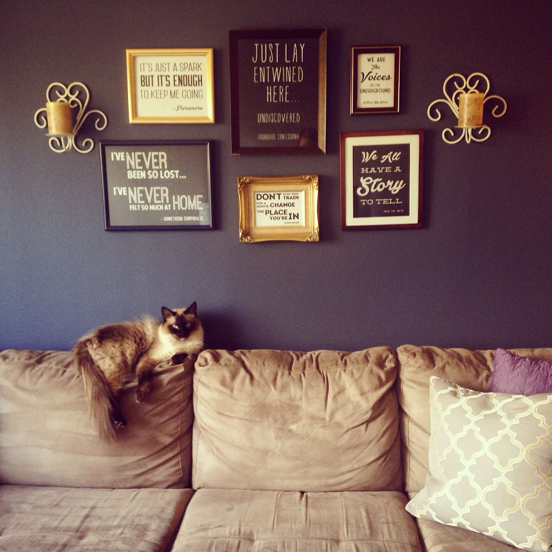 Song Lyric Wall Collage!   I had a friend who was crafty with photoshop whip up some prints of my favorite song lyrics. Then I dug through my parents' basement and found some random mismatched frames (but you can also buy them for SUPER cheap at the dollar store and spray paint them) and got these sconces at a garage sale! Fun, easy, CHEAP diy project that is one of a kind!