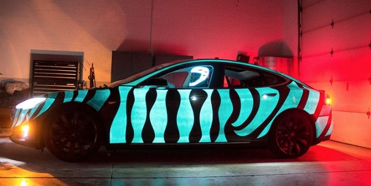 Electroluminescent Paint Lights Up The Tesla In Racing Extinction