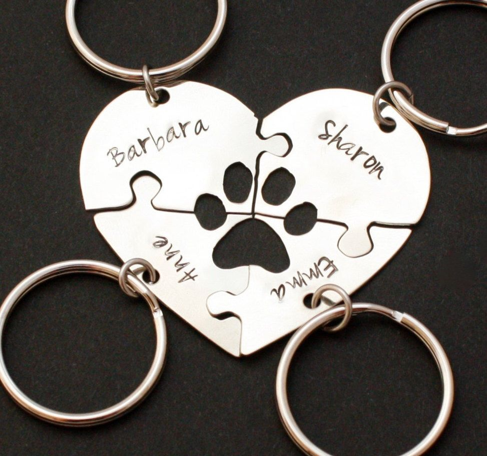 #Doglovers #pawprint #heartpuzzle keychains, custom keychains for dog lovers, dog loving friends, rescue, paw print key ring for friends by InspiredByBronx on Etsy https://www.etsy.com/listing/483762811/dog-lovers-pawprint-heart-puzzle